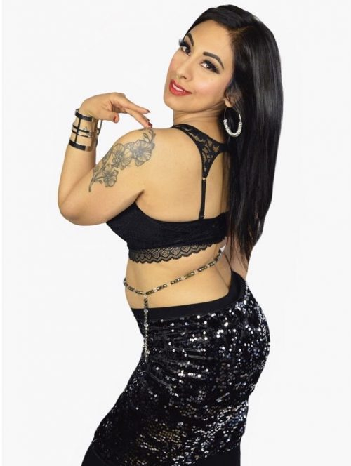 Bellydancer in black sequence posing with a dark beaded bellybelt.